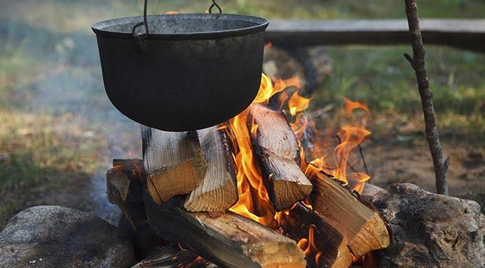 Preparing food on campfire